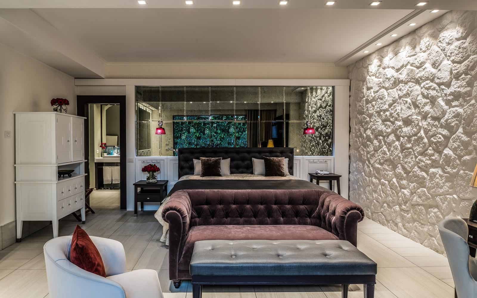 Room's living area at Forte Village Villa del Parco