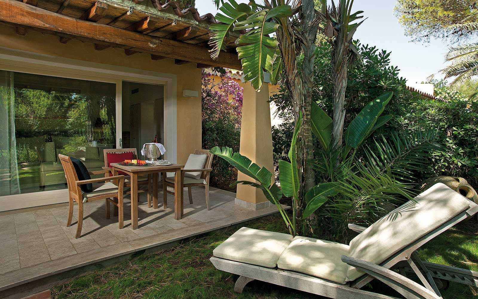 A deluxe bungalow patio at Forte Village Le Dune