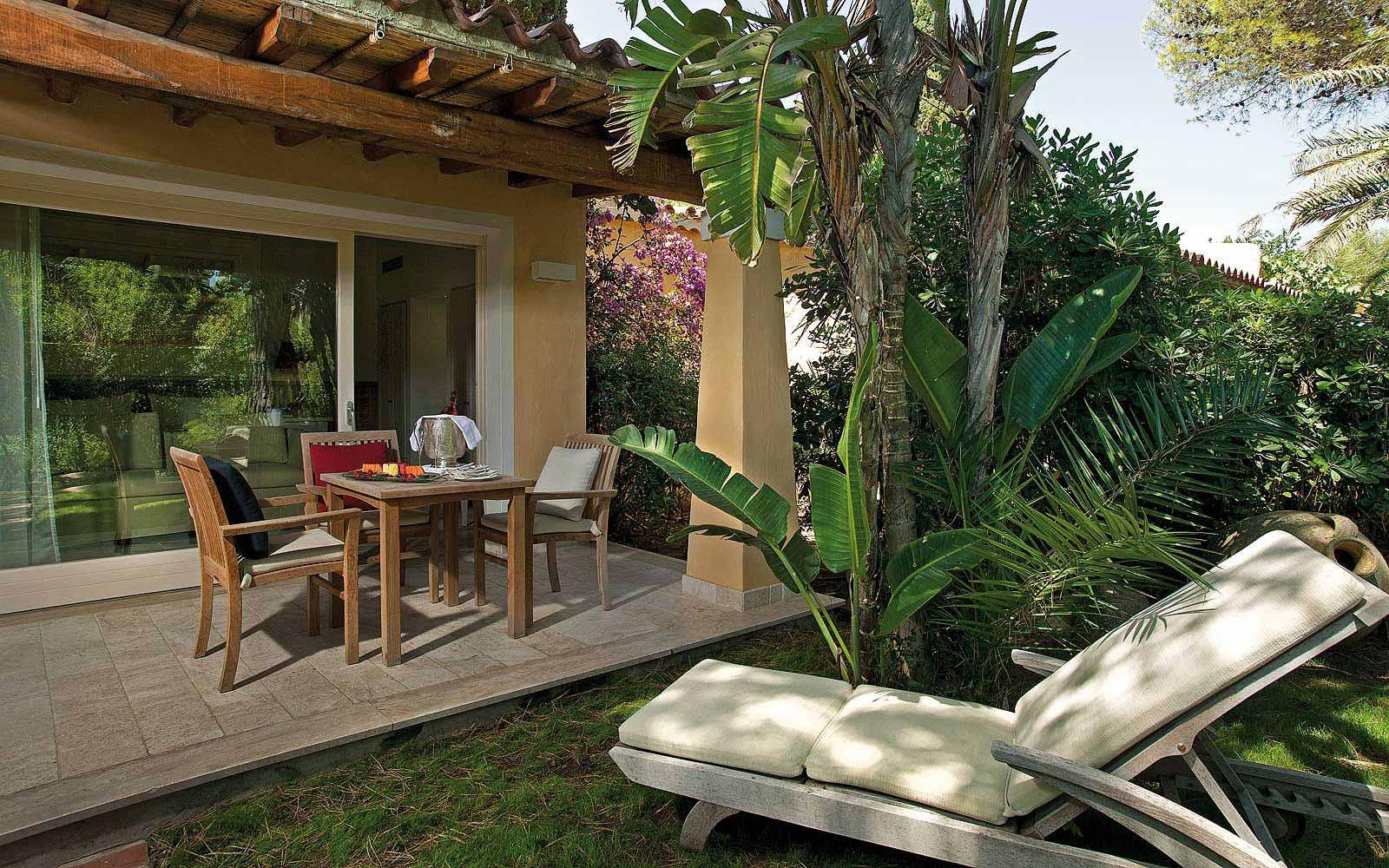 A Deluxe Bungalow patio at Forte Village Le Dune