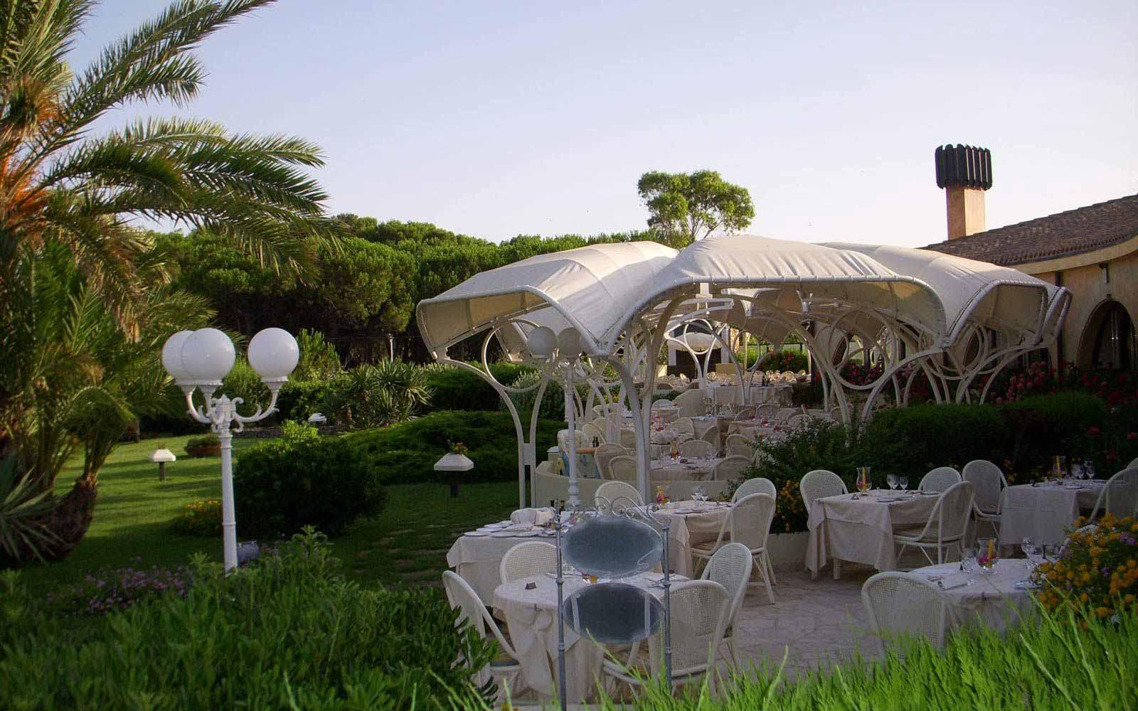 Outdoor dining at Hotel Baia Di Nora