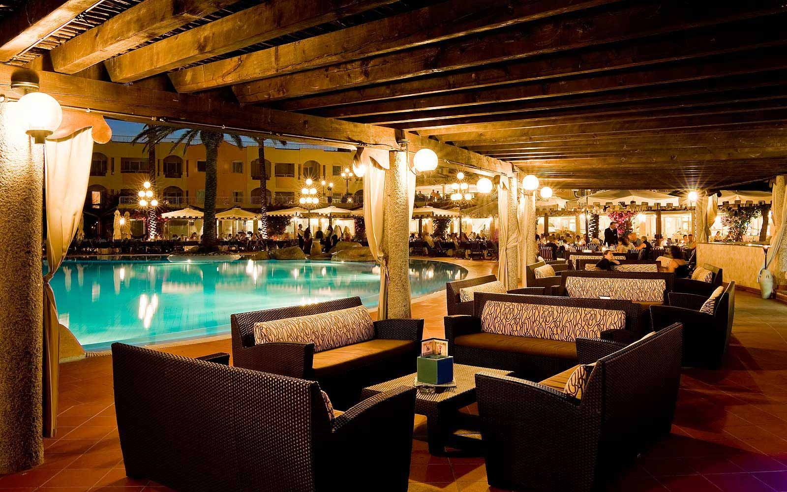 Pullman Timi Ama Sardegna's pool bar at night