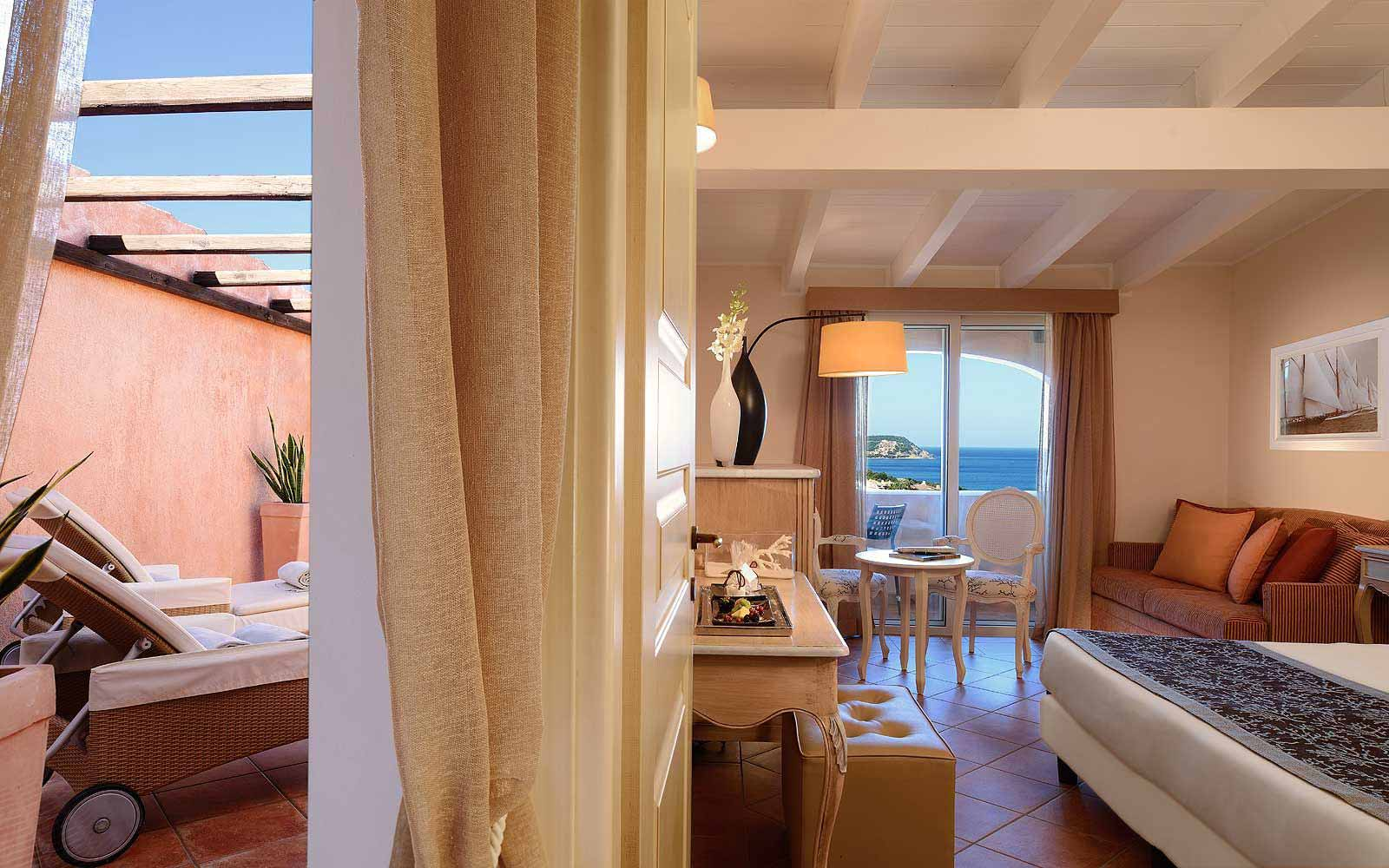 Deluxe Room with private terrace at Colonna Pevero Hotel