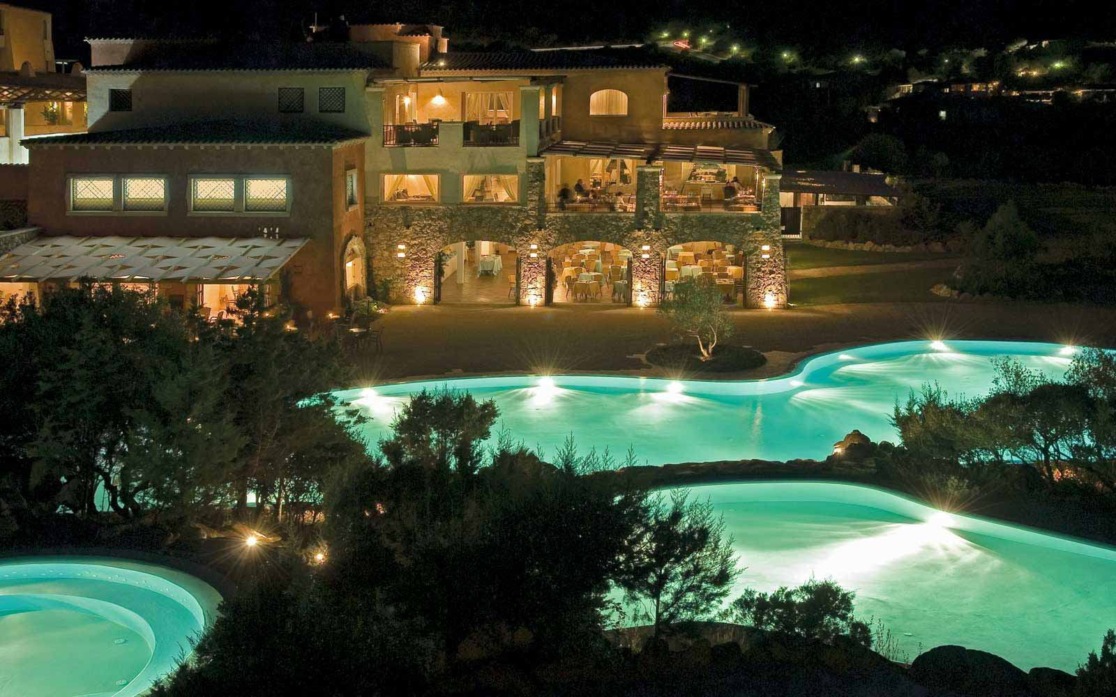 Swimming pool at night time at Colonna Pevero Hotel
