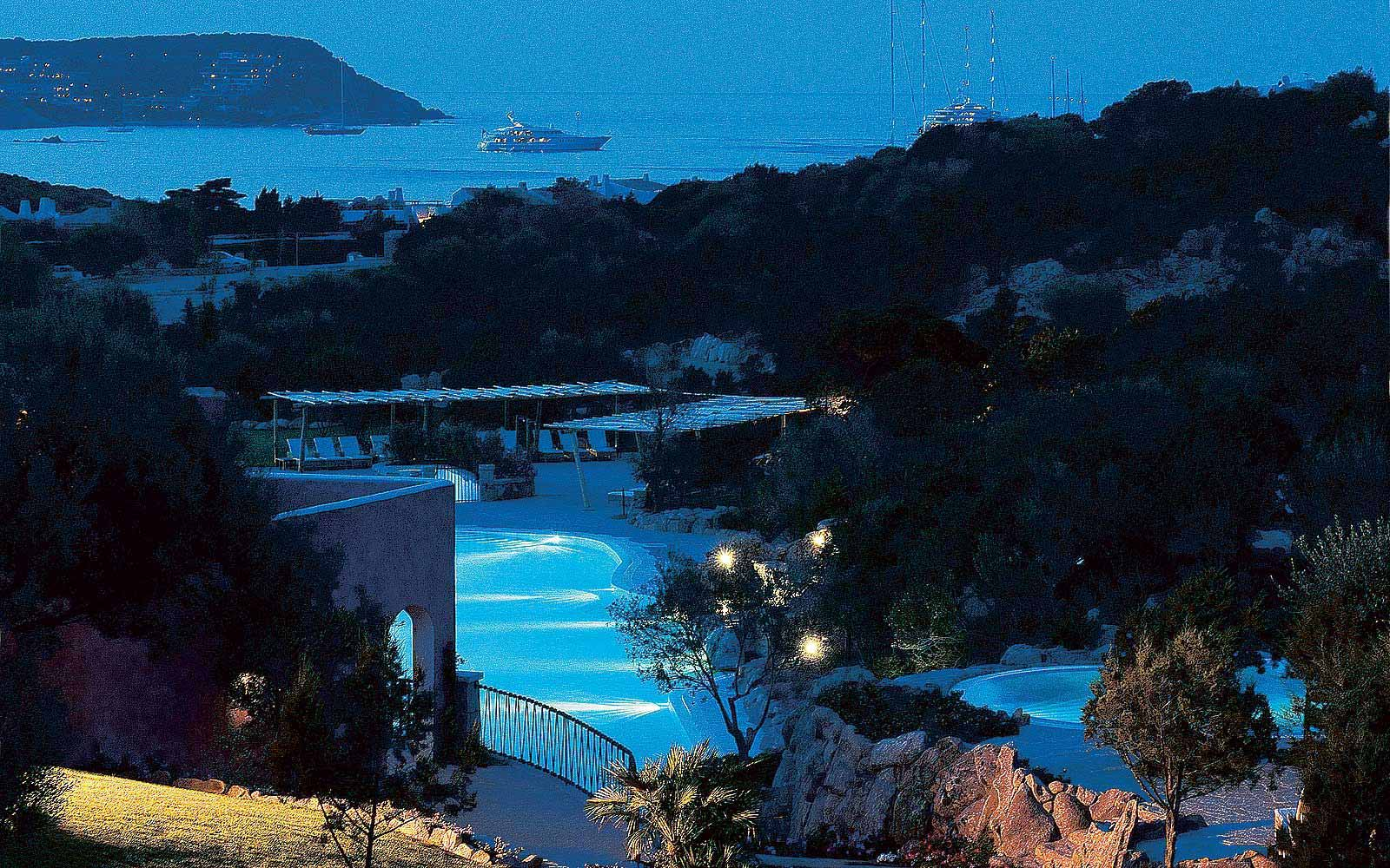 View of the bay during the night at Colonna Pevero Hotel
