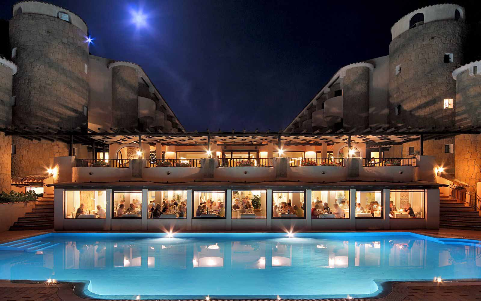 Swimming pool by night at Grand Hotel Smeraldo Beach