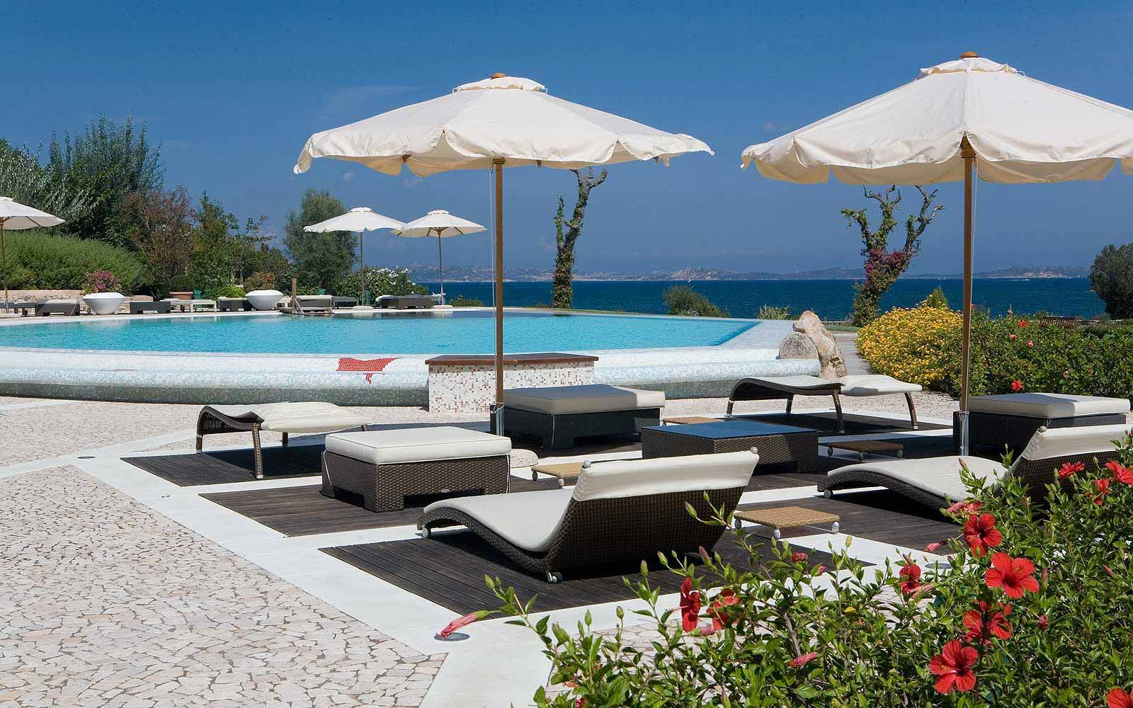 Sunbeds by the pool at L'Ea Bianca Luxury Resort