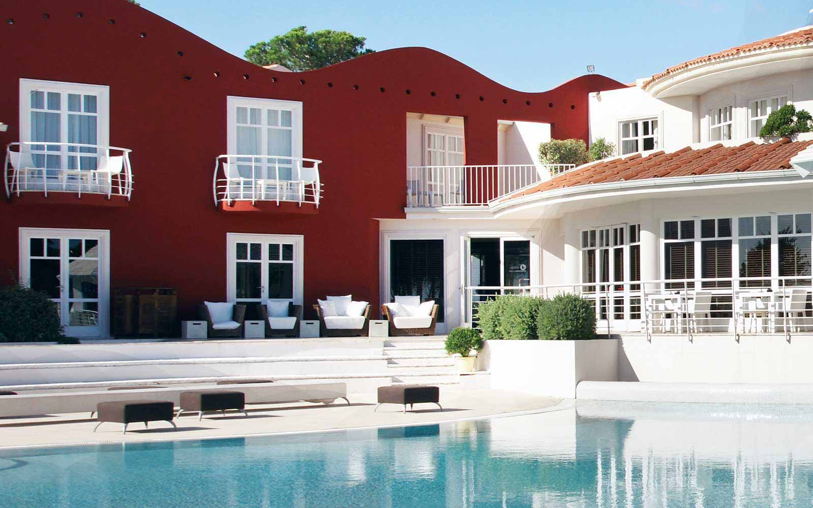 Relax by the swimming pool at La Coluccia Hotel & Beach Club