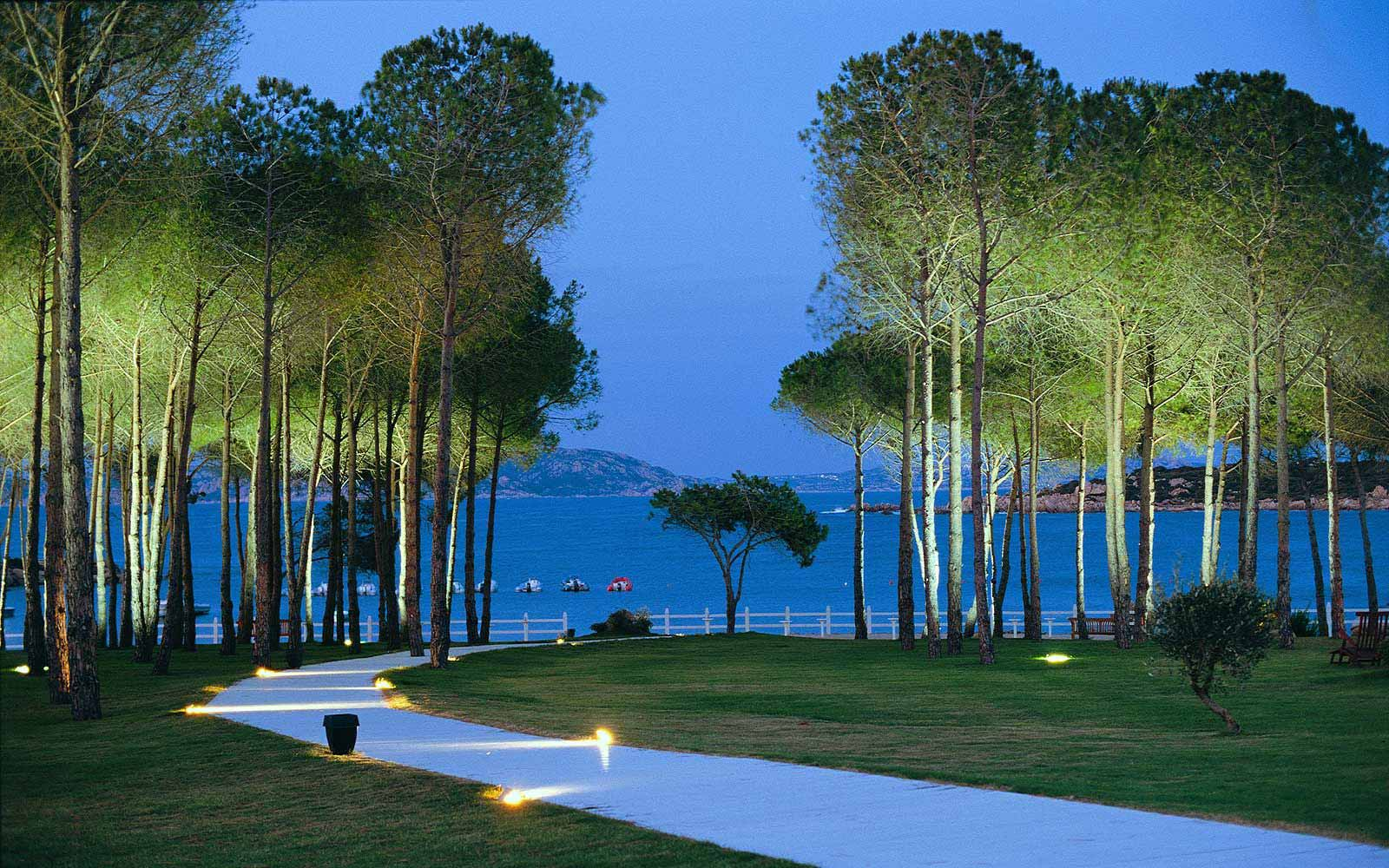 La Coluccia Hotel & Beach Club's pathway to the beach at night