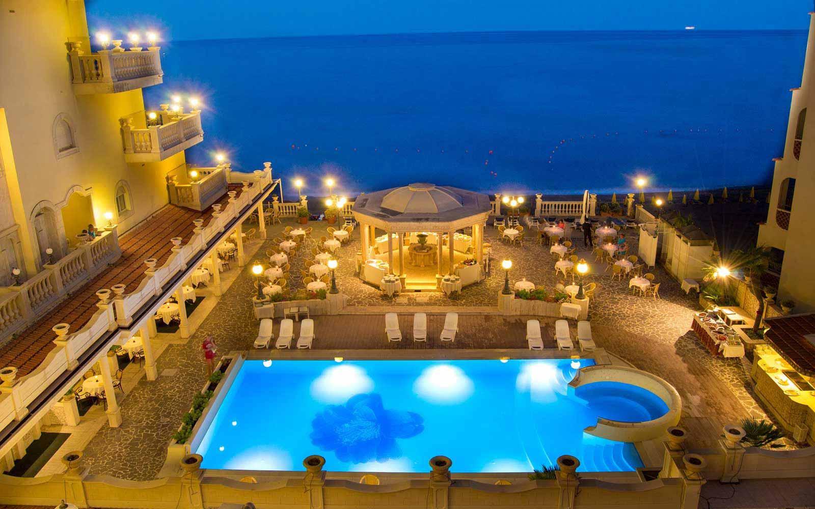 Swimming pool at night at Hellenia Yachting