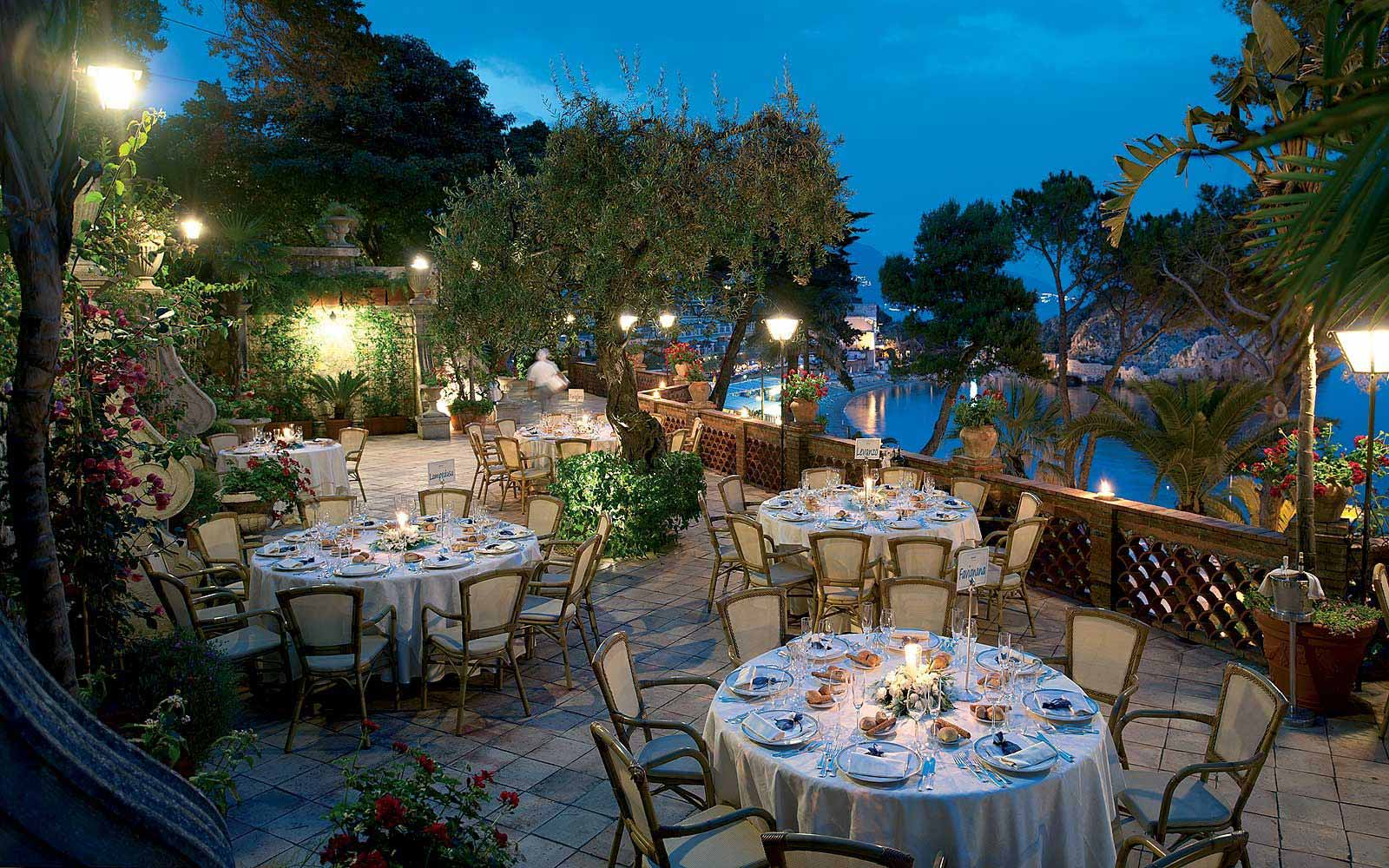 Banquet terrace at night at Belmond Villa Sant' Andrea