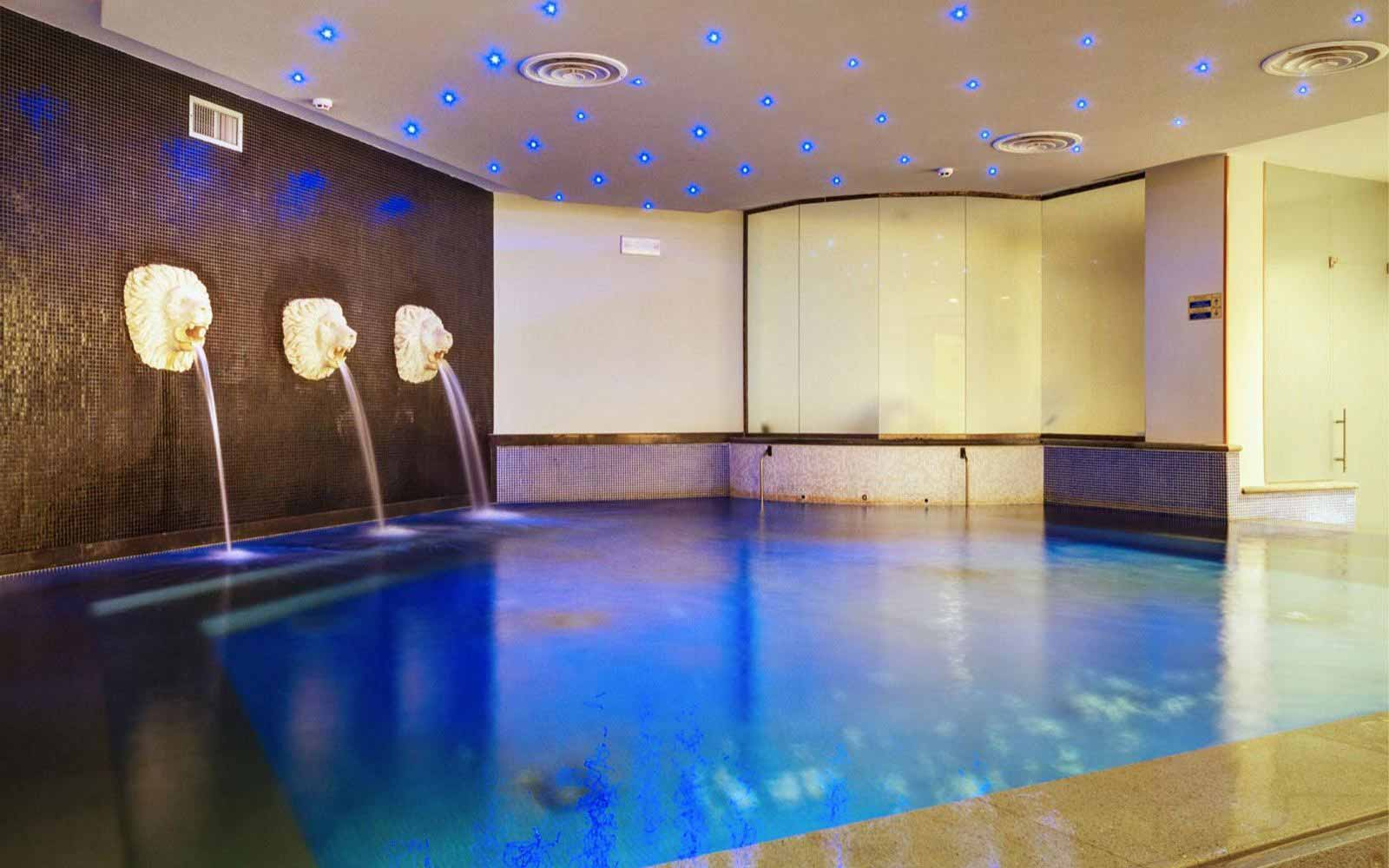 Indoor pool at Des Etrangers Hotel & Spa