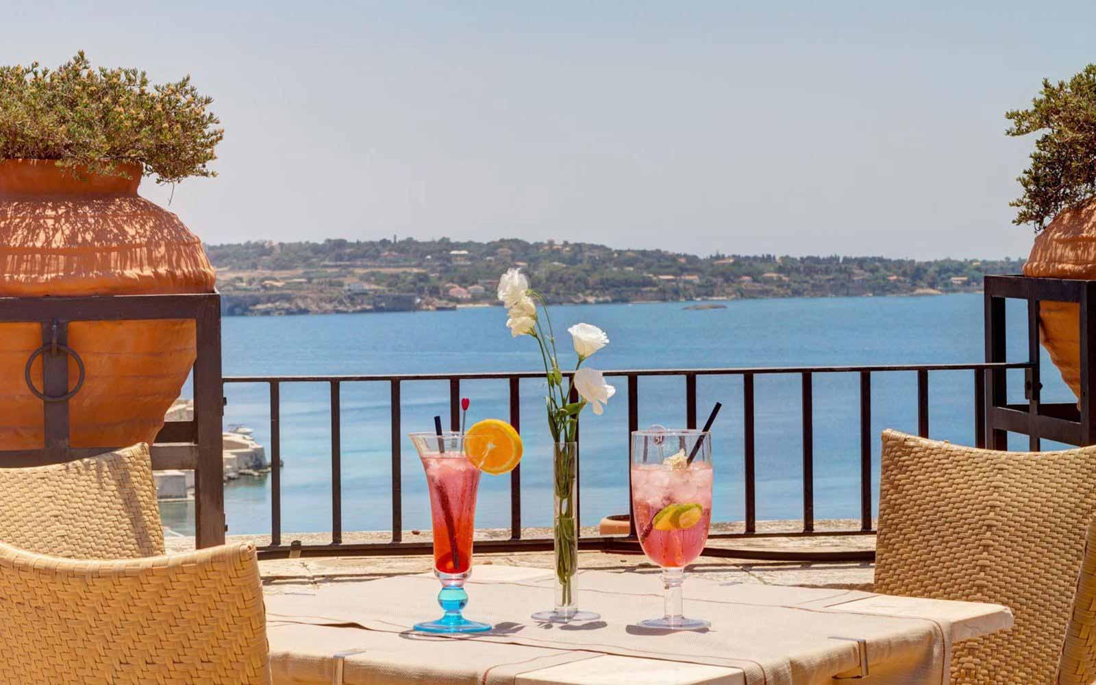 Cocktails on the terrace at Des Etrangers Hotel & Spa et Miramare