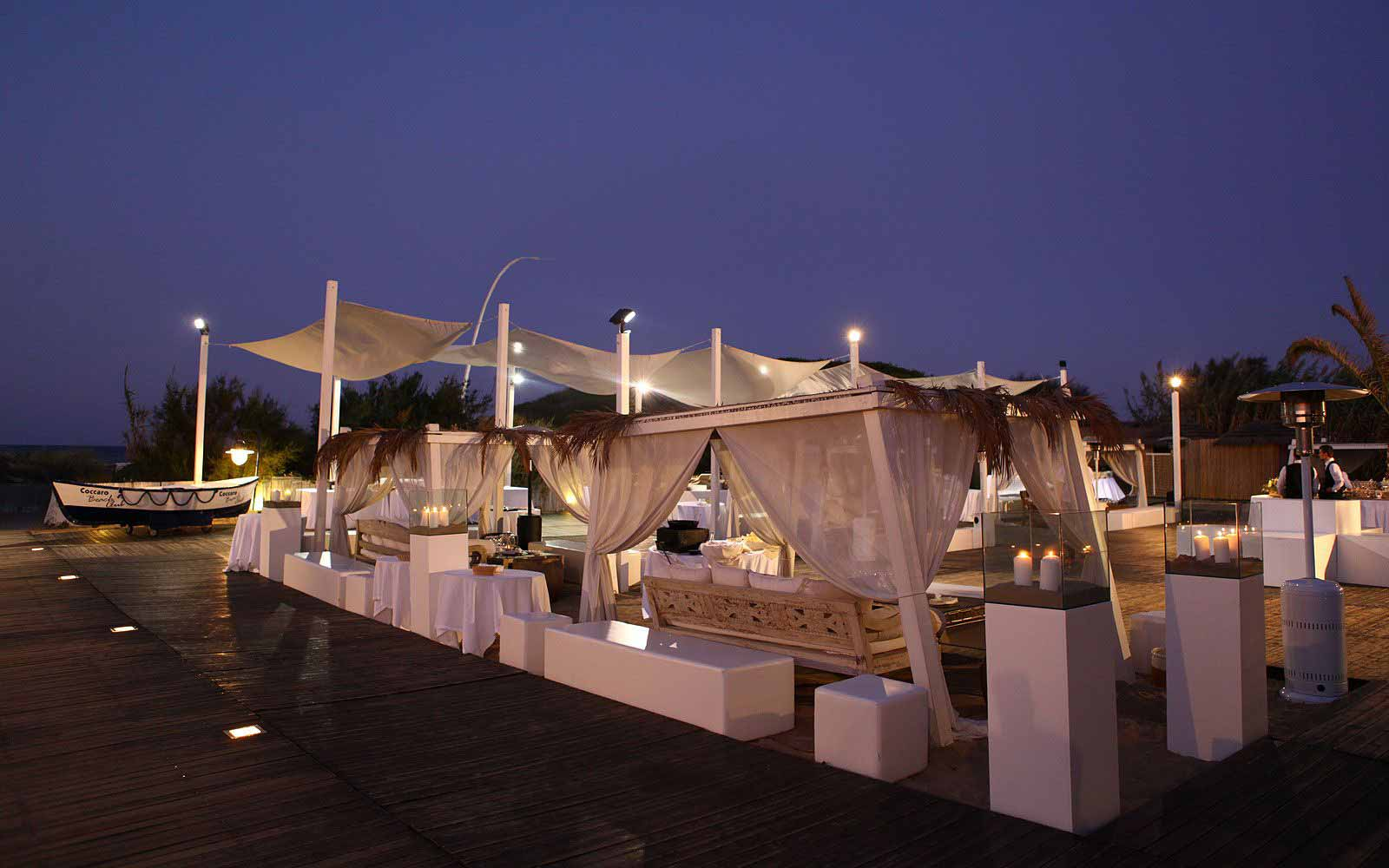 Outdoor lounge by the beach at Masseria Torre Coccaro