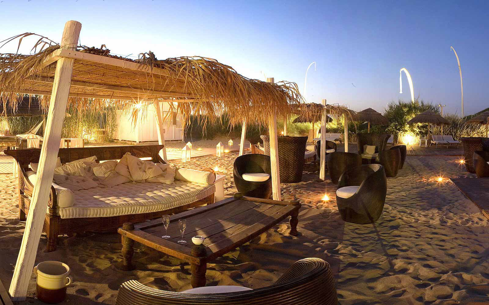 Outdoor lounge by the beach at Masseria Torre Maizza