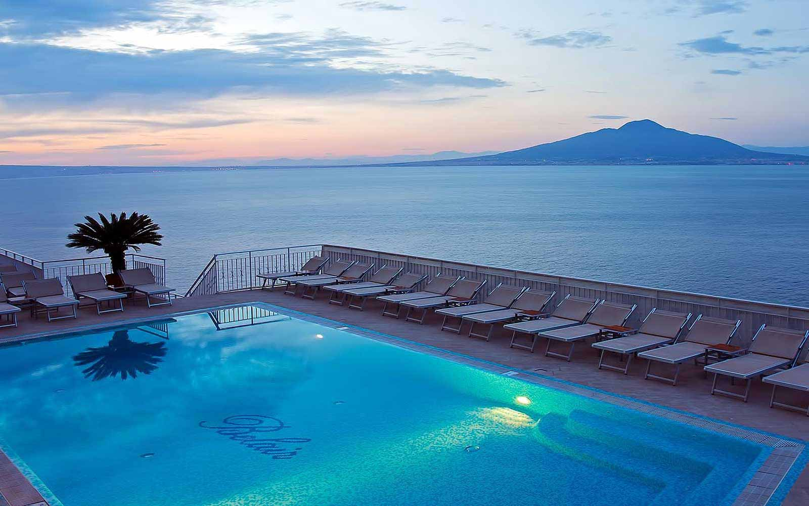 Swimming pool at Hotel Belair with Mount Vesuvius