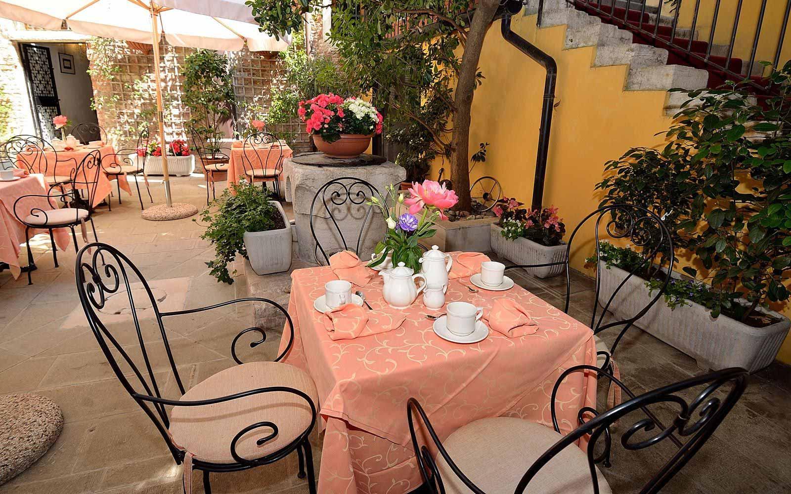 Breakfast on the terrace at Hotel Locanda La Corte