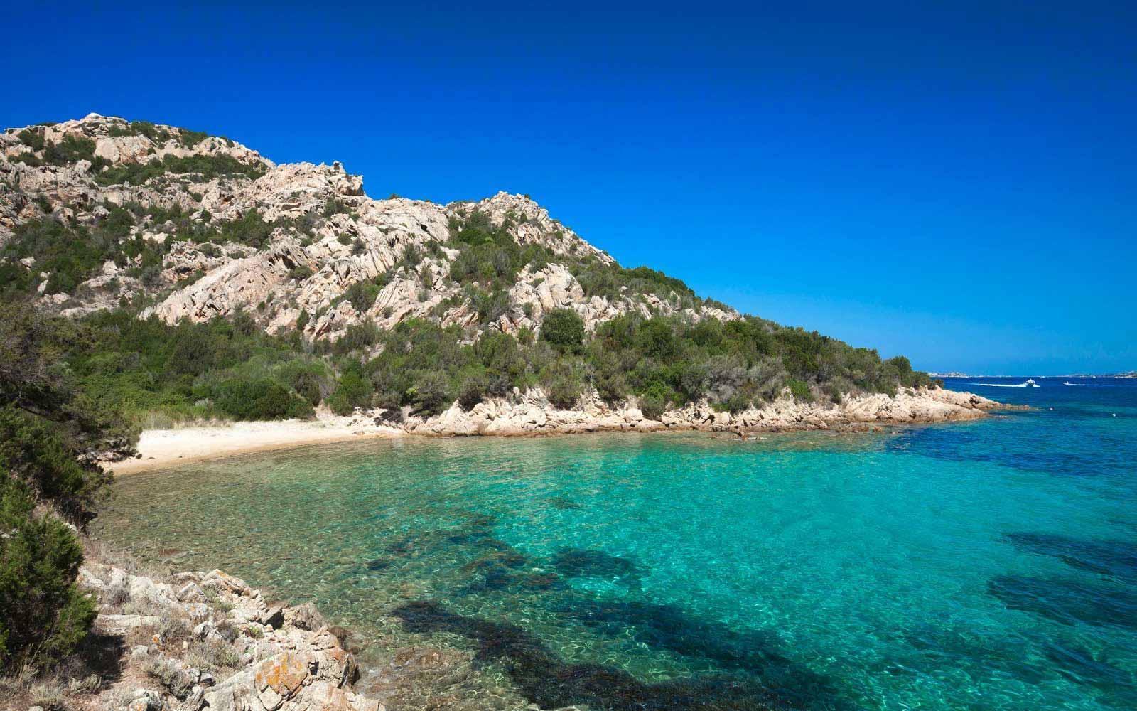 Cala Selvaggia beach by Hotel Capo D'Orso Thalasso & Spa