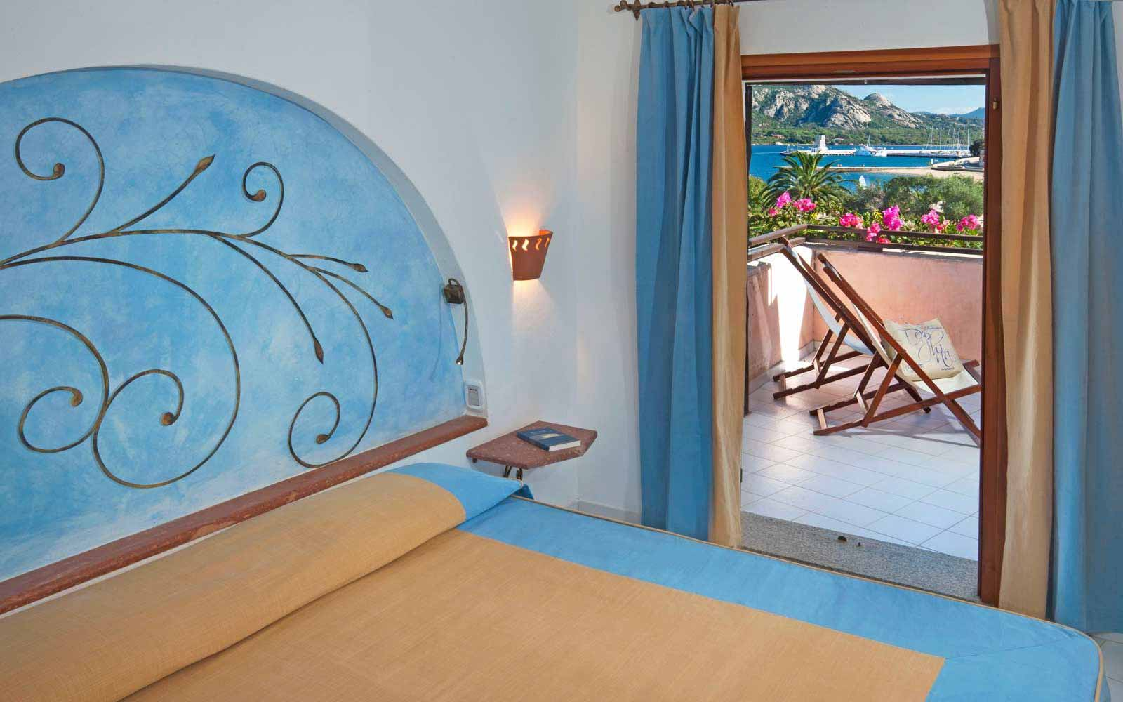 Suite bedroom Il Borgo at Resort Cala di Falco