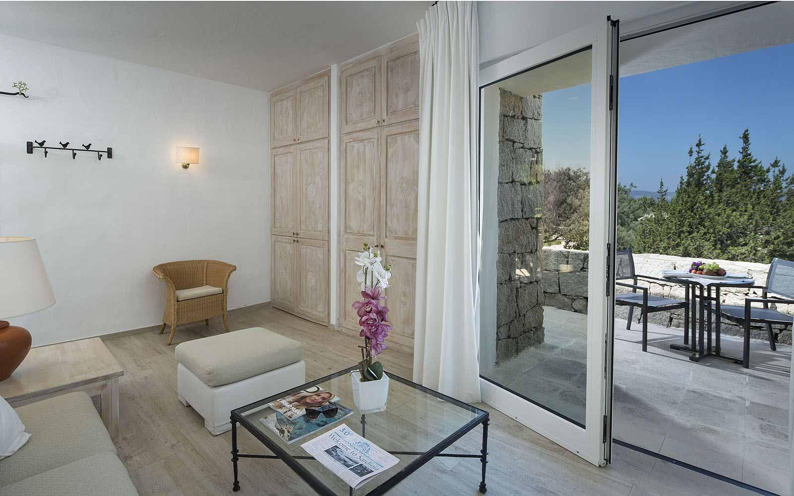 Junior Suite lounge area and patio at the Grand Relais dei Nuraghi