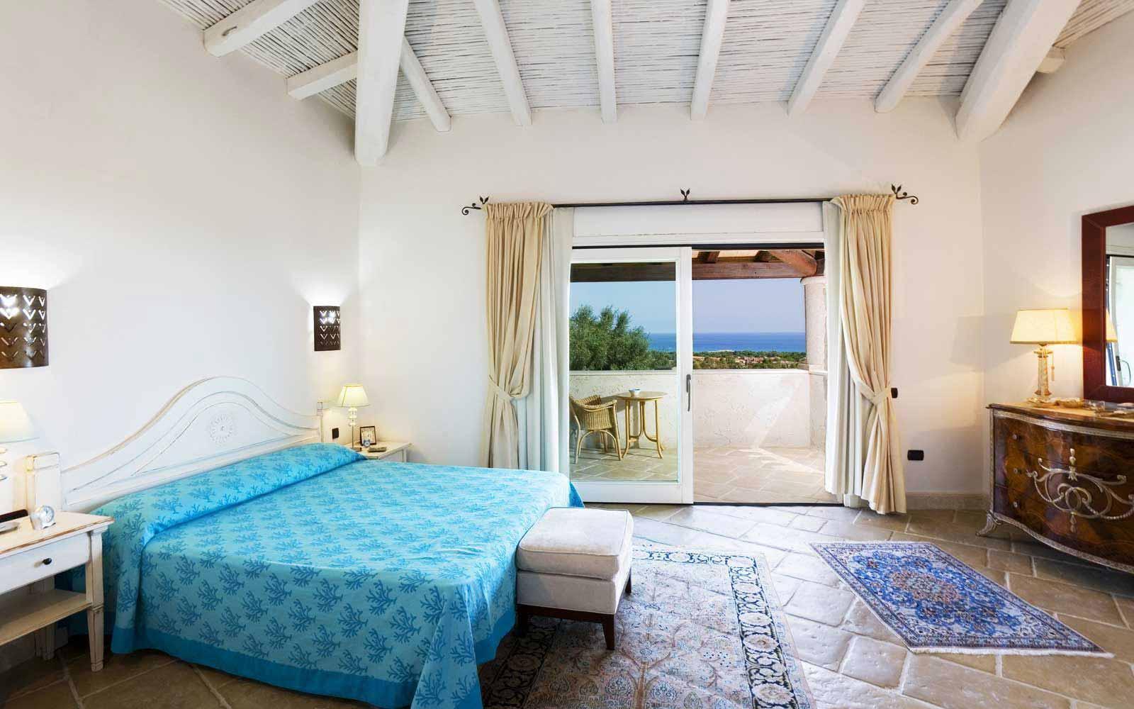 A bedroom in Villa Olivastro at Hotel Villas Resort - Villas