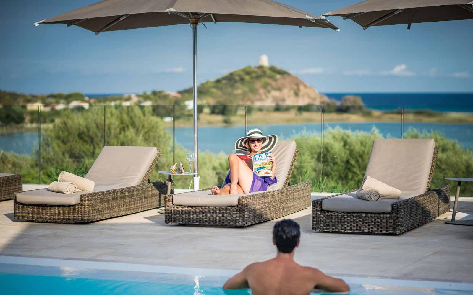 Relax by swimming pool at the Chia laguna resort