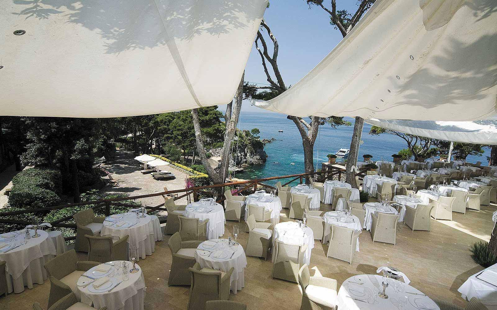 Chandelier Restaurant outdoors at Mezzatorre Resort & Spa