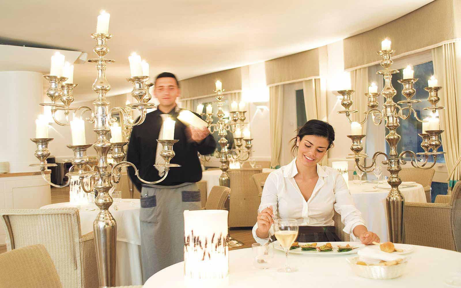Chandelier Restaurant indoors at Mezzatorre Resort & Spa