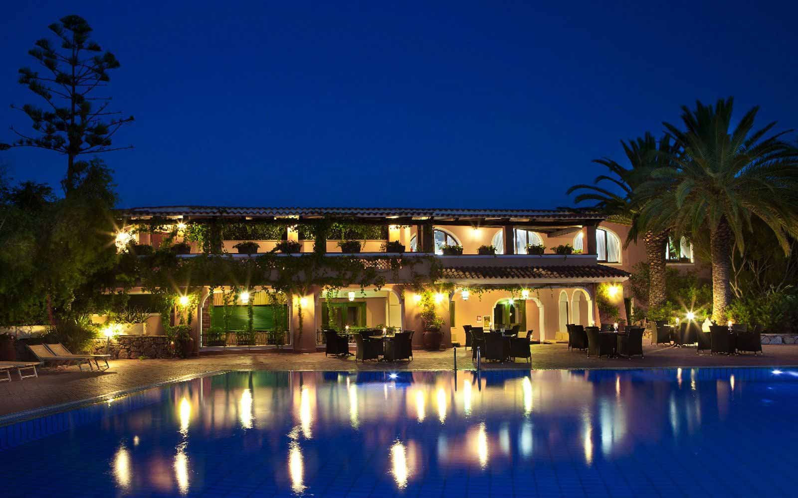Cala Ginepro Hotel Resort at night