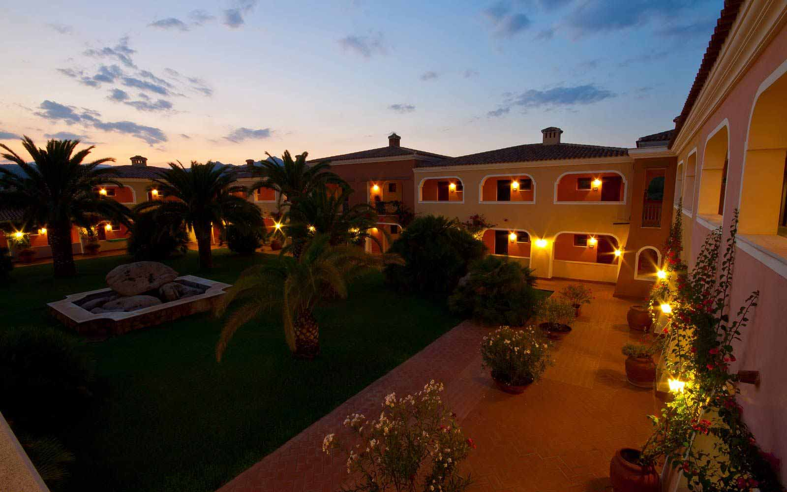 Sunset over I Giardini di Cala Ginepro Hotel Resort