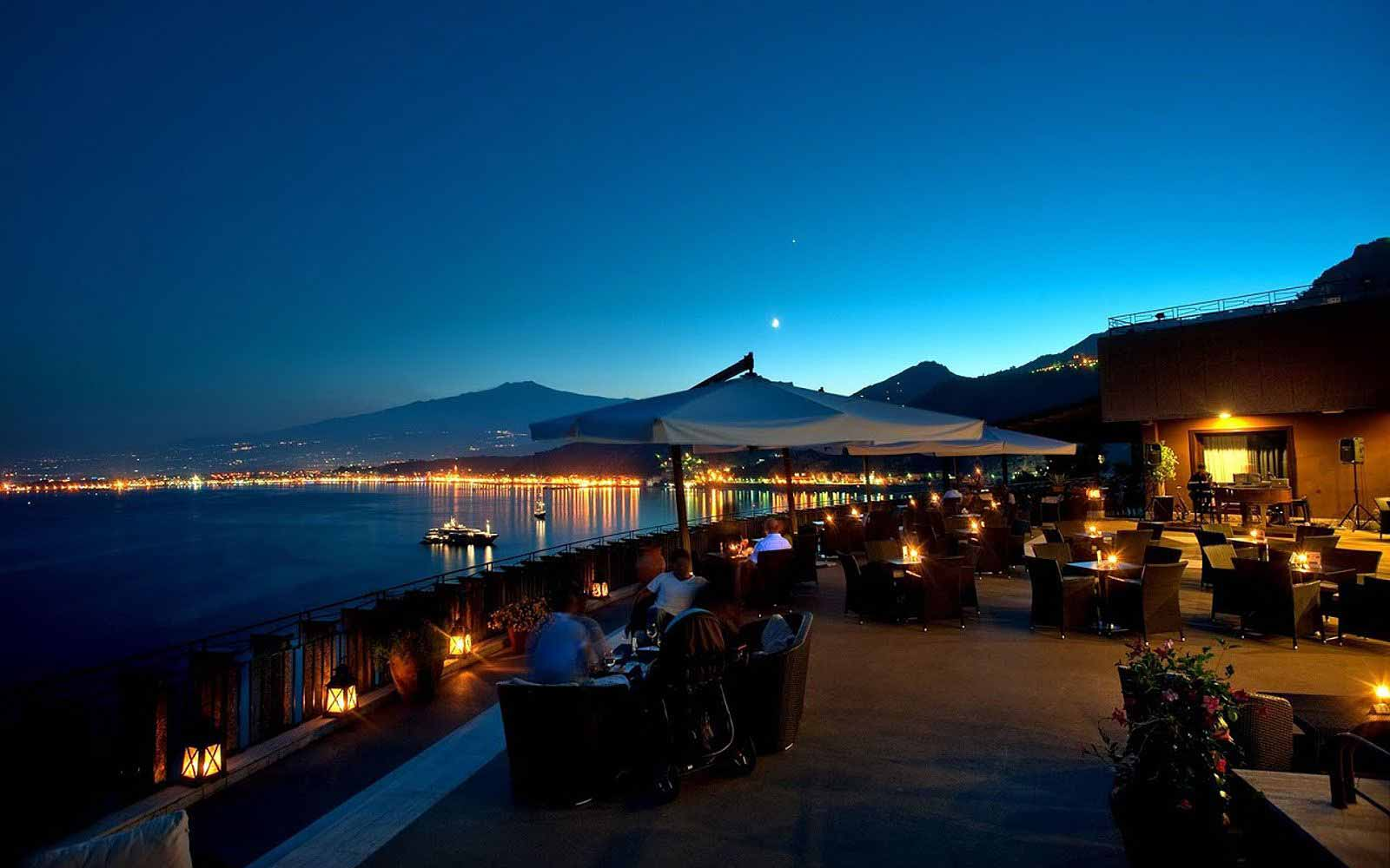 Terrace of the Atahotel Capotaormina with Mount Etna in the distance