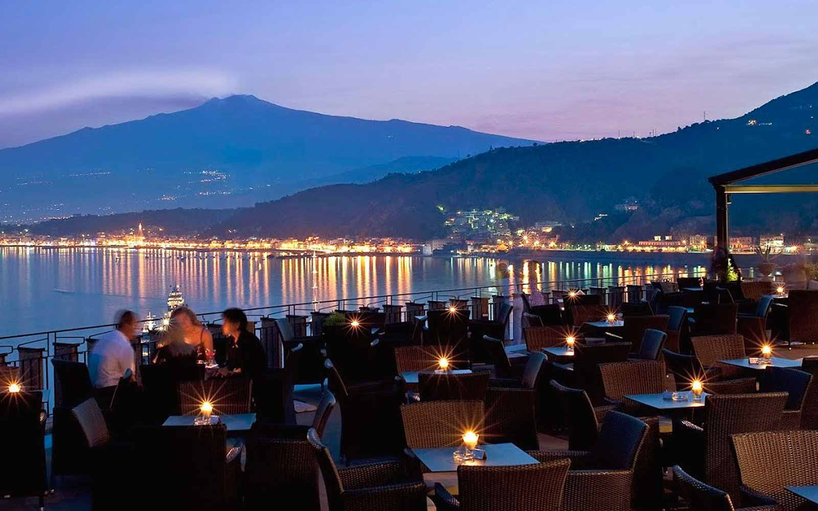 Terrace of the Atahotel Capotaormina with Mount Etna & Naxos in the distance