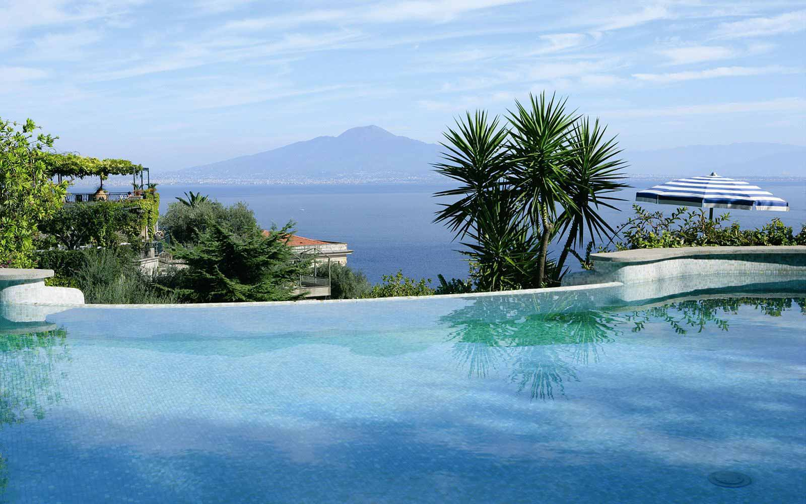 Swimming pool at Grand Hotel Capodimonte with views of Mount Vesuvius