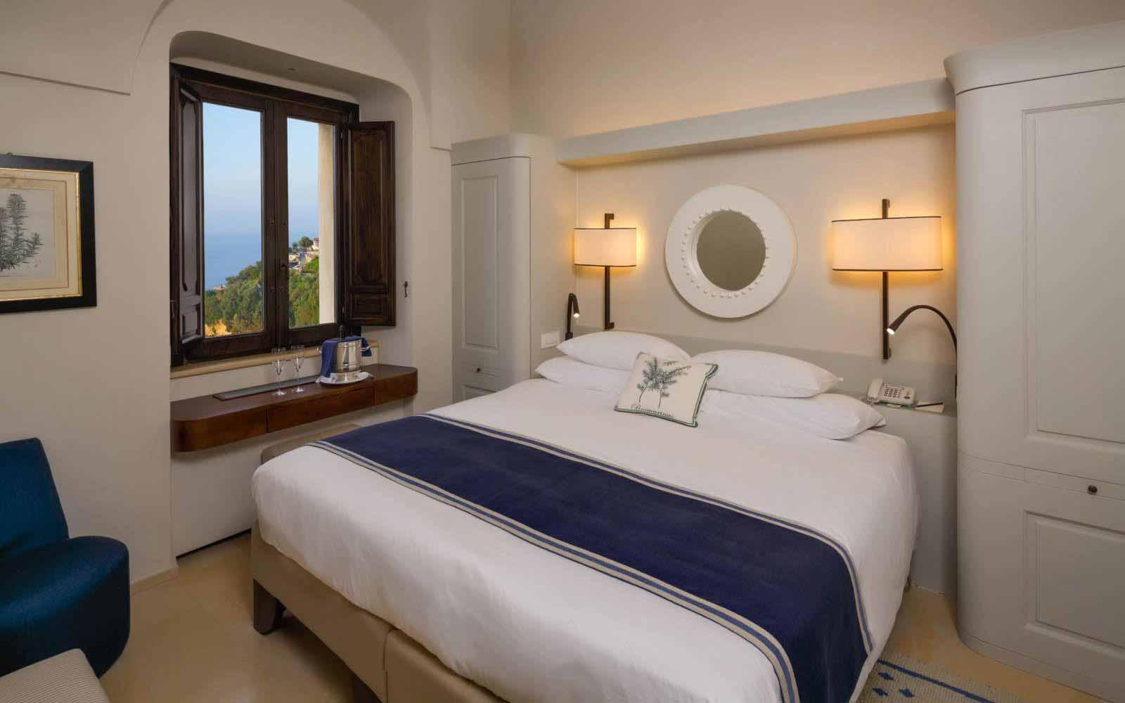 Deluxe bedroom at Monastero Santa Rosa