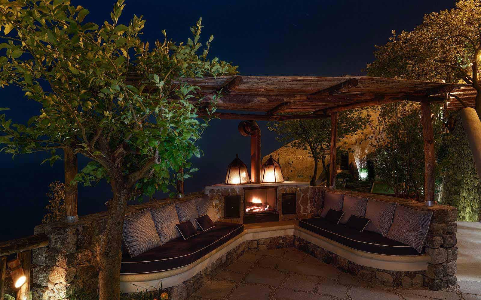 Outdoor fireplace at Monastero Santa Rosa