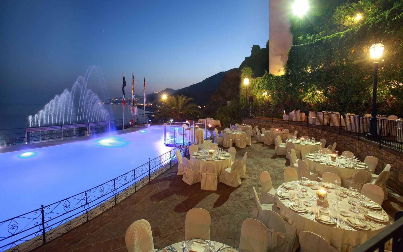 Dinning by the pool at Hotel Baia Taormina