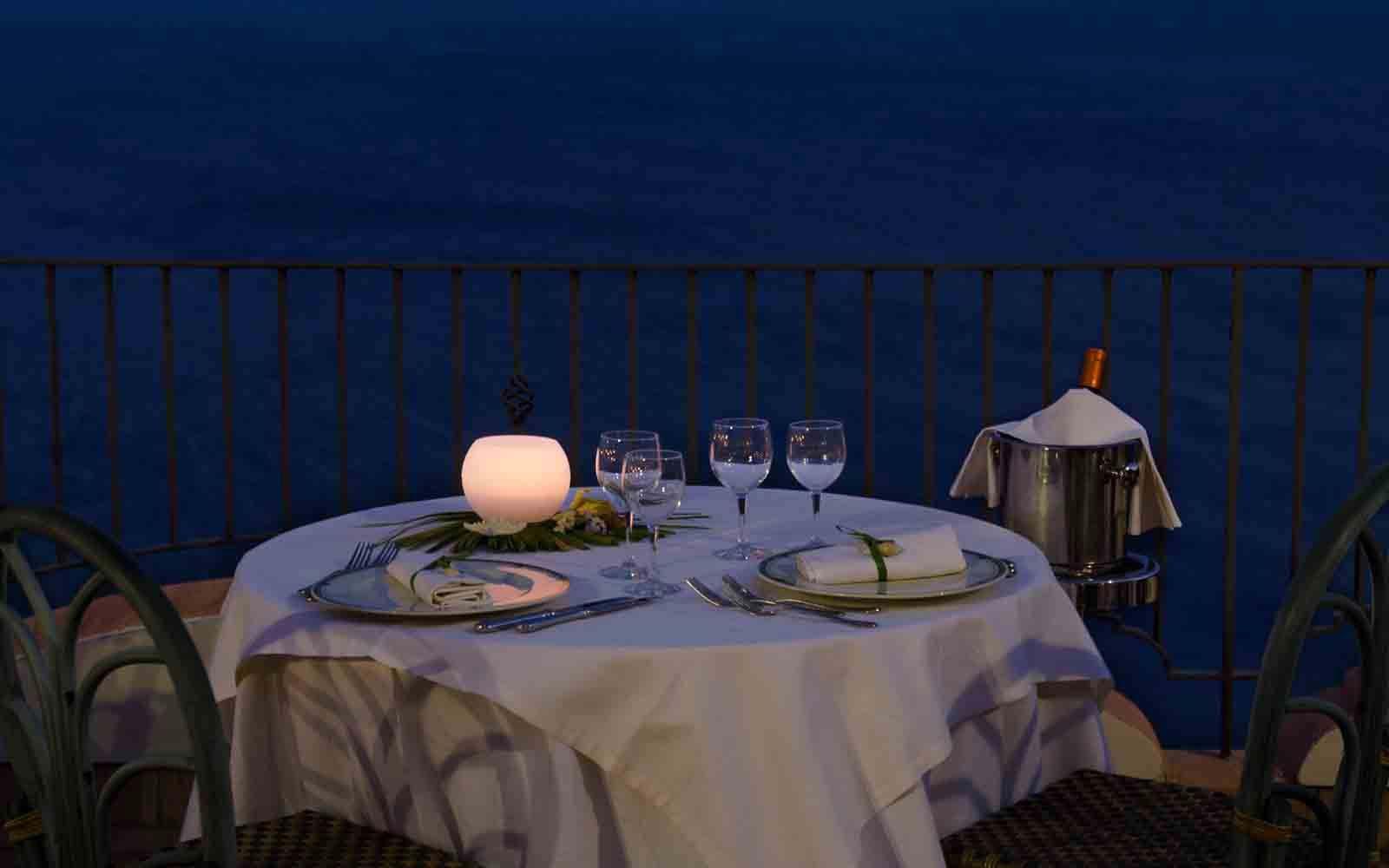 Candlelit outdoor dinning at Hotel Baia Taormina