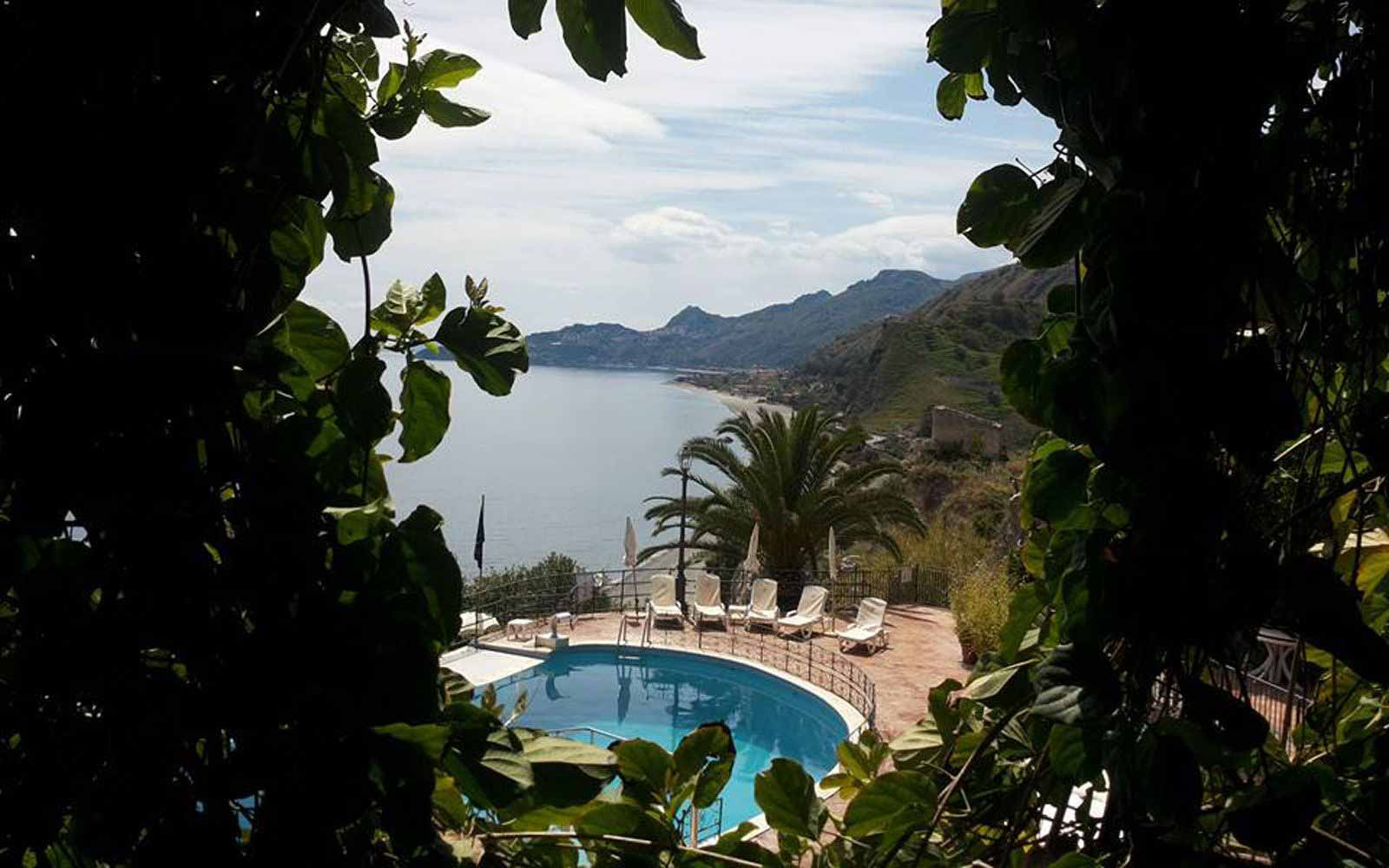 Pool with view over the bay of Taormina at Hotel Baia Taormina