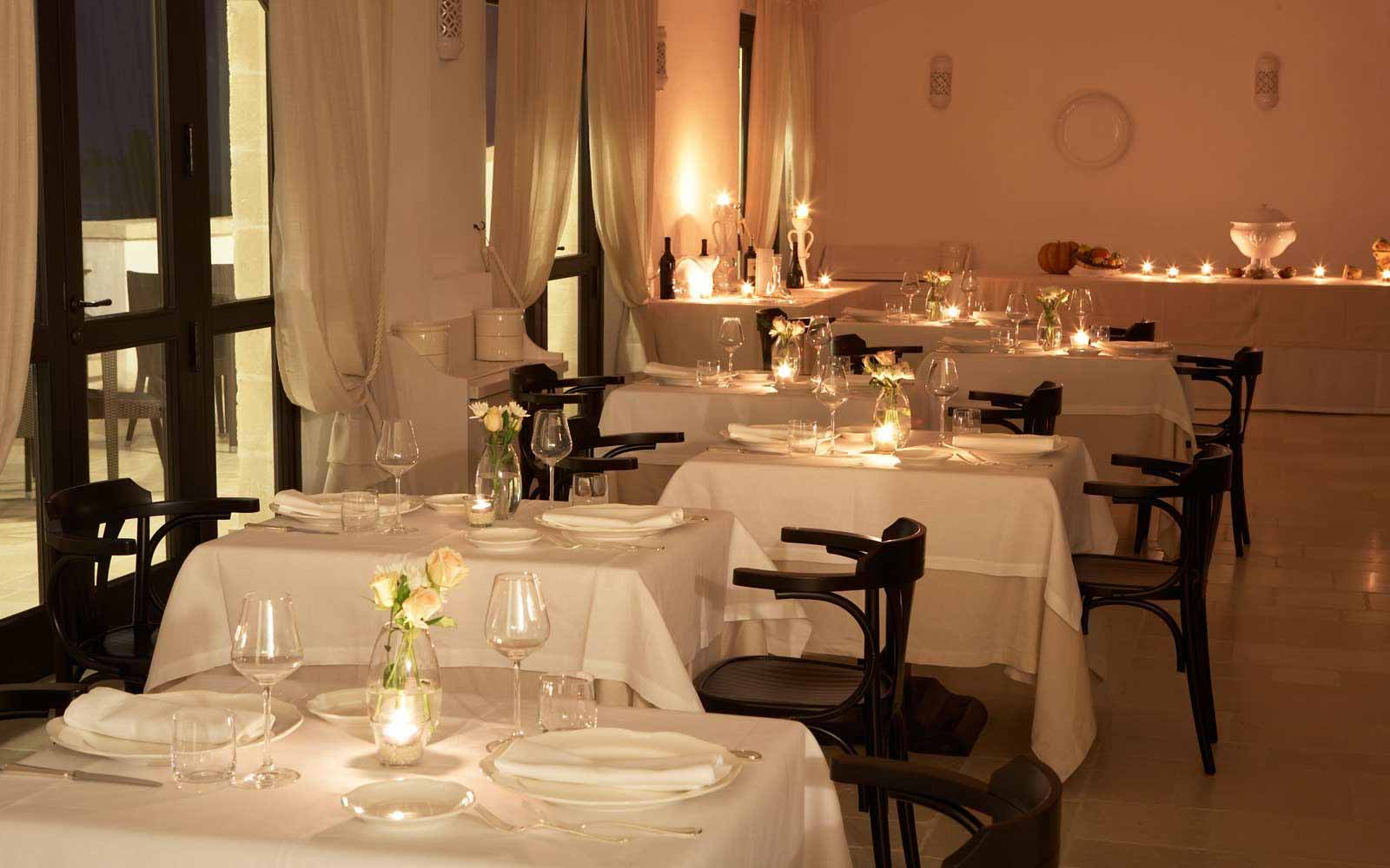 White restaurant at Borgobianco Resort & Spa