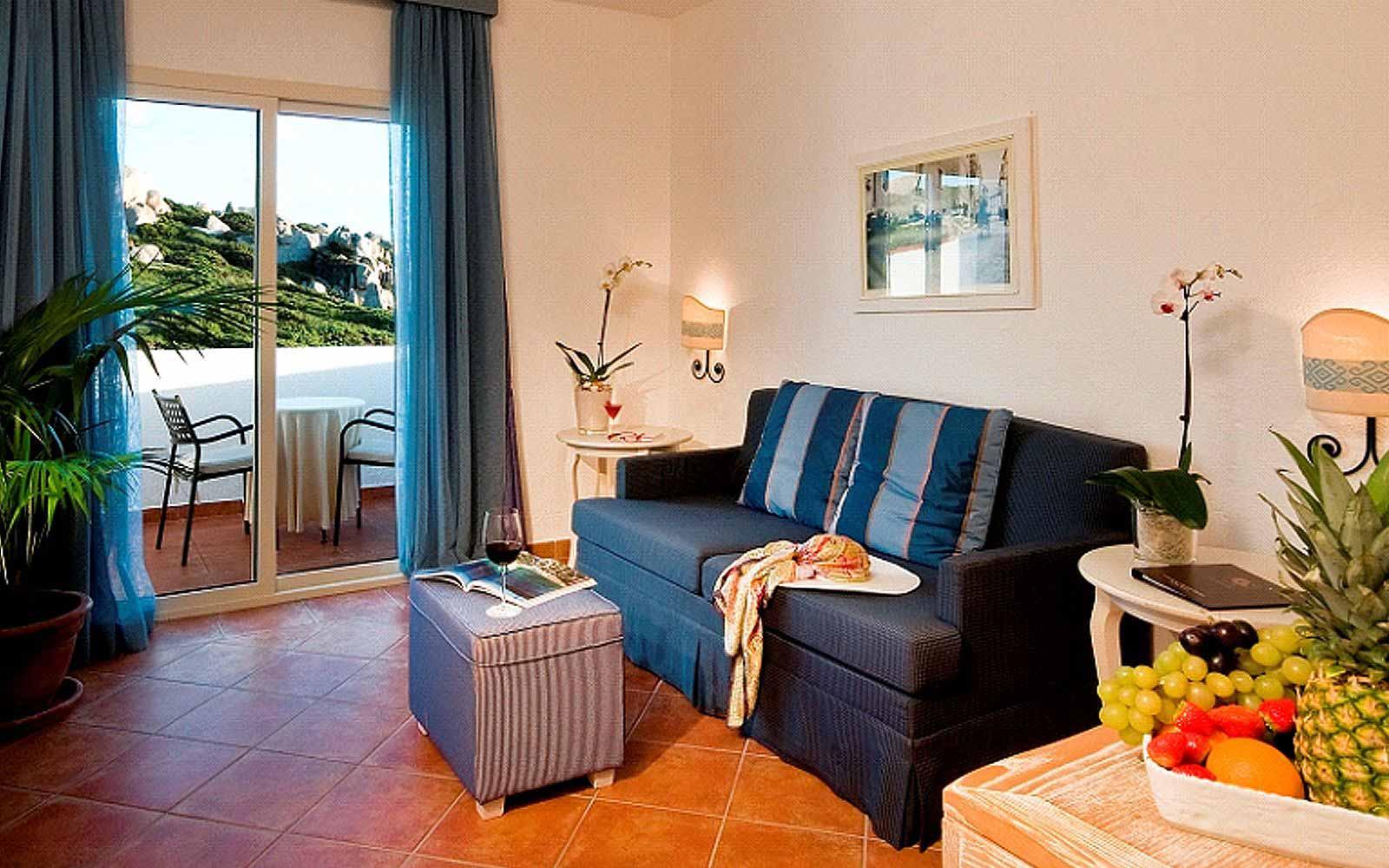 Family room at the Colonna Grand Hotel Capo Testa