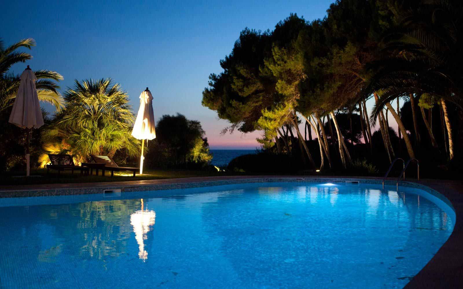 Swimming pool at night Hotel Cala Caterina