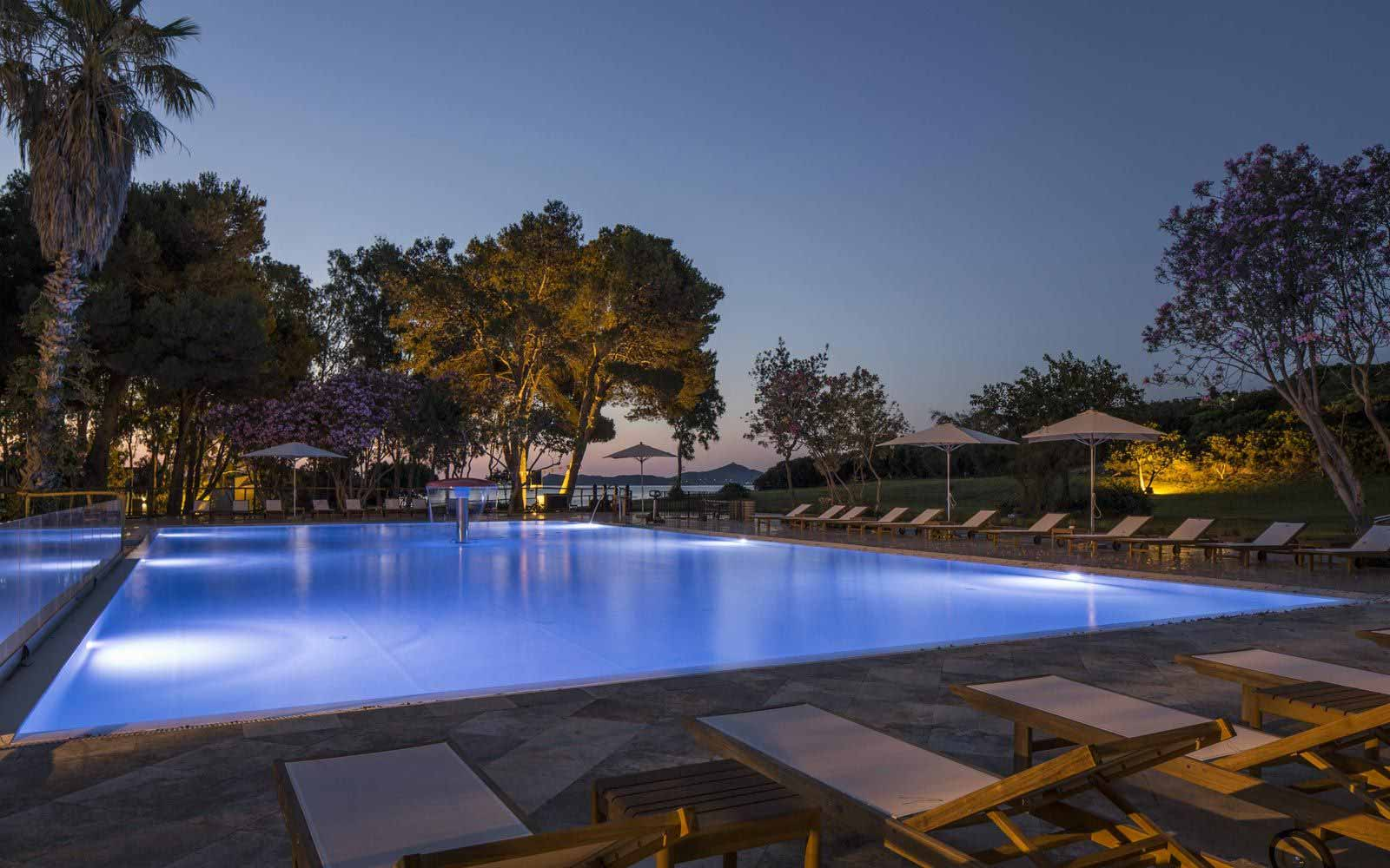 Pool by night at Falkensteiner Resort Capo Boi