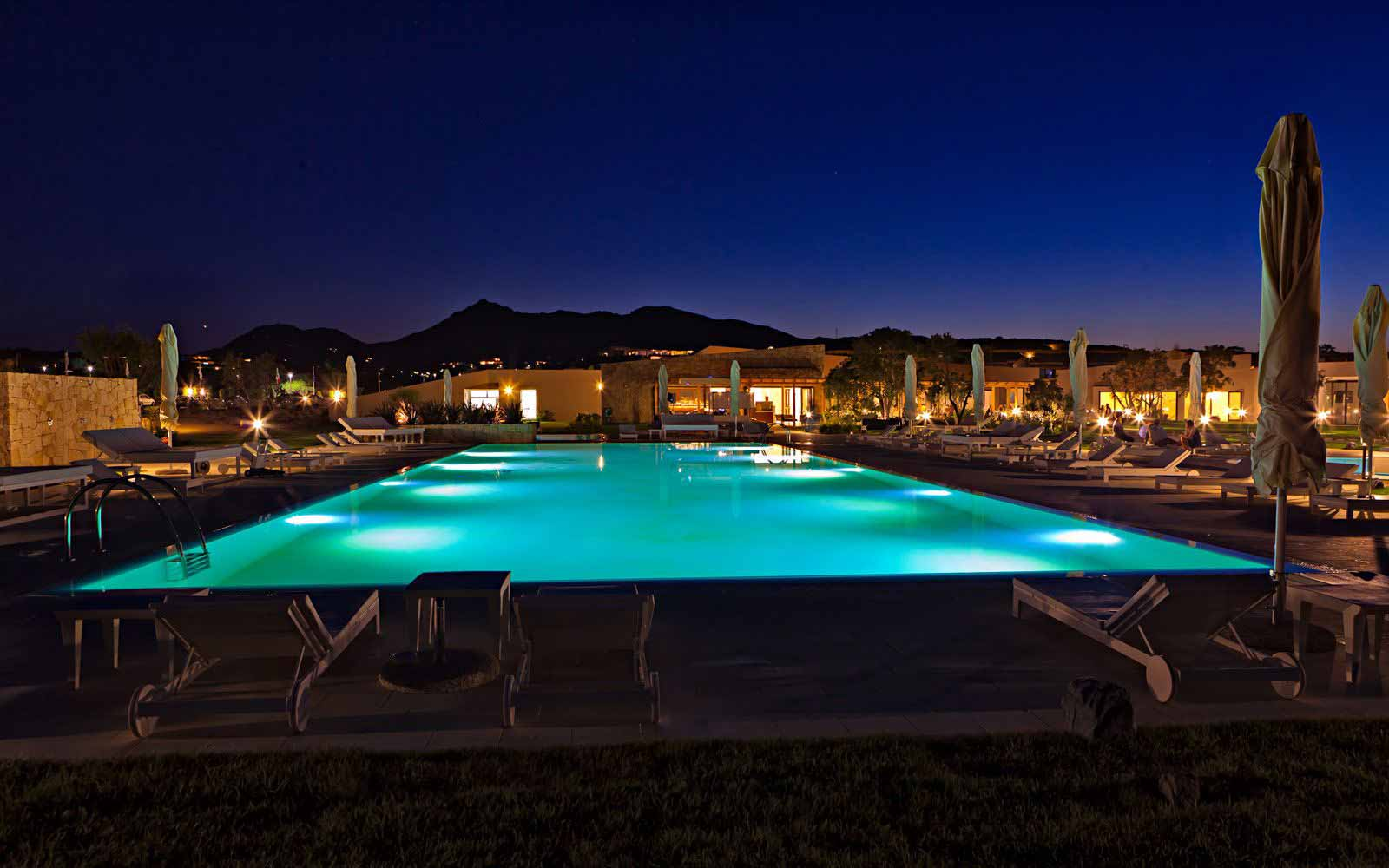 Pool by night at Paradise Resort