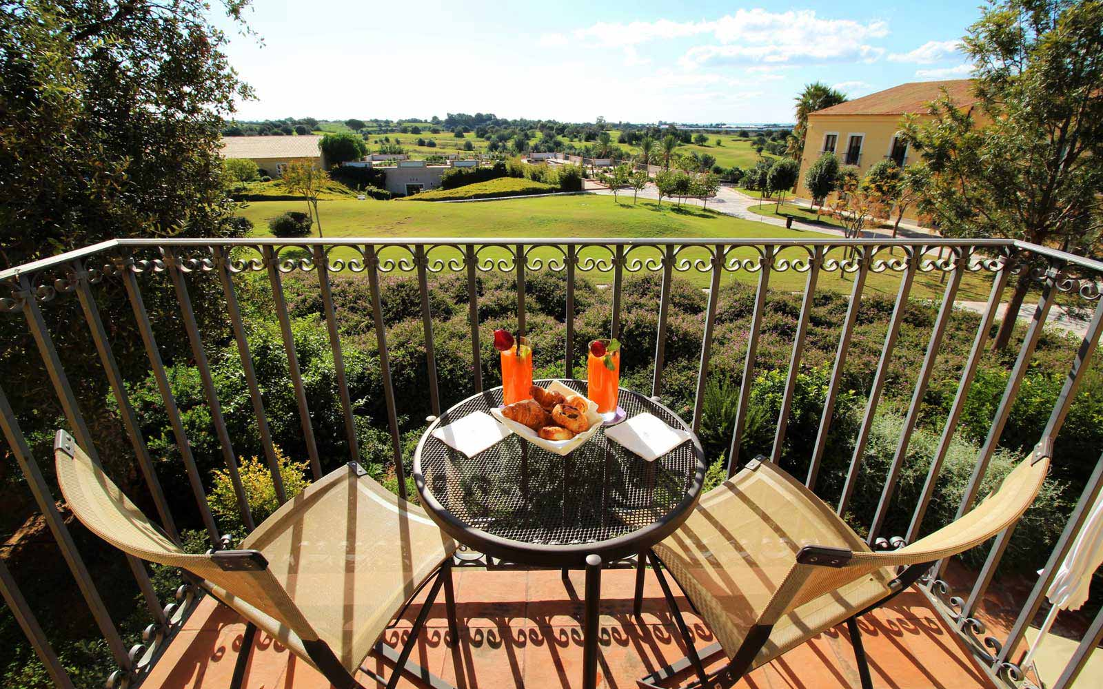 Deluxe balcony view at Donnafugata Golf Resort & Spa