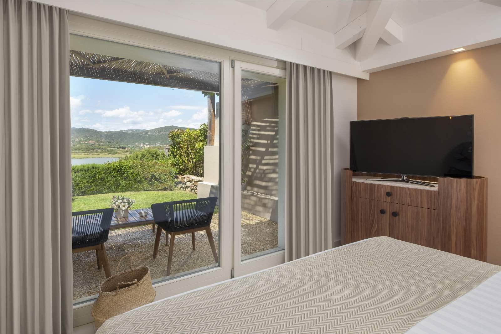 Baia Di Chia Resort King Deluxe Room with Lagoon View